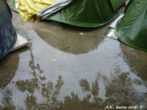 Eole migrants sous la pluie